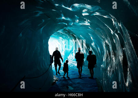 Tourists inside the ice cave in Mer de Glace glacier, Montenvers. Chamonix Valley, French Alps, France.