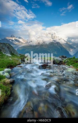 Stream beneath Aiguille Verte, Chamonix Valley, French Alps, France. - Stock Photo