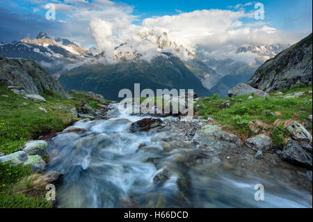 Stream beneath Aiguille Verte, Chamonix Valley, French Alps, France. - Stock Photo