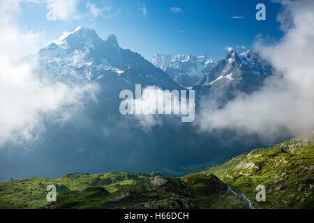 Aiguille Verte rises across the Chamonix Valley, Haute Savoie, French Alps, France. - Stock Photo
