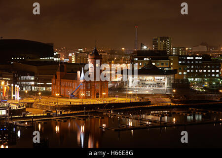 Cardiff Bay at night South Wales showing the Pierhead building and the welsh assembly building - Stock Photo