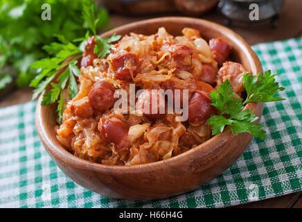 Polish bigos with smoked sausage and bacon - Stock Photo
