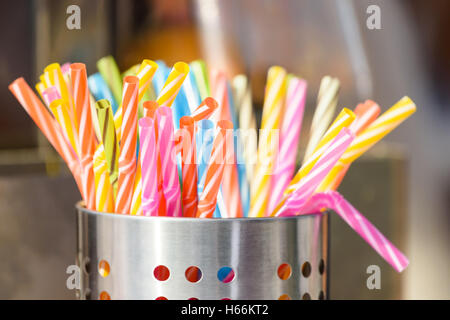 Colorful Plastic Straws In Metal Can - Stock Photo