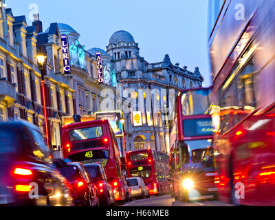 LONDON TRAFFIC JAM Theatreland West End theatres busy heavy pollution diesel fumes gridlock with red buses and taxis - Stock Photo
