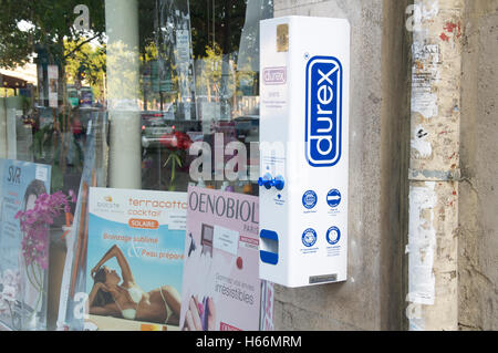 Contraception, chemist shop. A wall mounted vending machine dispensing Durex condoms outside a pharmacy on a Parisian - Stock Photo