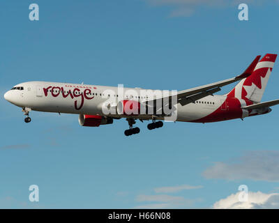 Air Canada rouge Boeing 767 (767-300ER) C-FMXC airliner final approach for landing Vancouver International Airport,Canada - Stock Photo