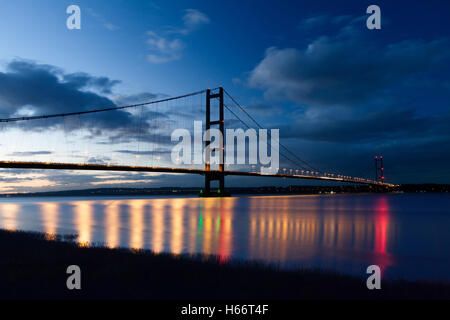 The Humber Bridge and the River Humber after dark. Barton-upon-Humber, North Lincolnshire, UK. 17th October 2016. - Stock Photo