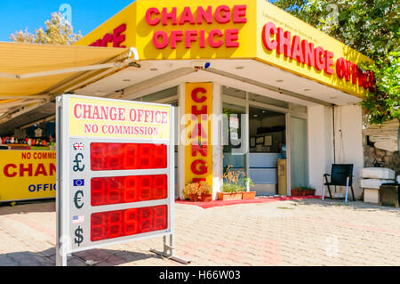 Bureau de change in bright yellow and red. - Stock Photo