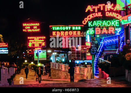 Shops, bars and restaurants in Hisaronu, Oludeniz, Fethiye, Turkey with neon and LED signs at night. - Stock Photo