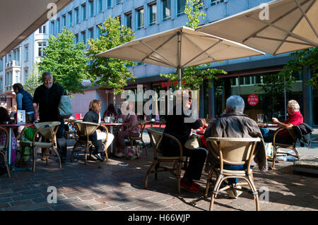 Customers sitting outside Gentile cafe bar in St. Gallen, Switzerland - Stock Photo