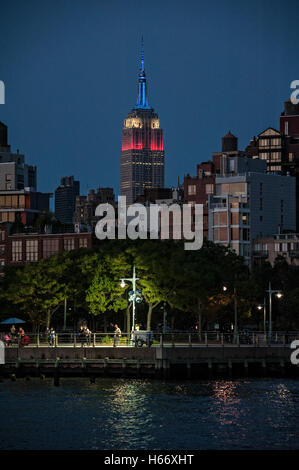 Hudson River Promenade, Pier 45, view of Empire State Building, lit in red, white and blue in honor of Labor Day, - Stock Photo
