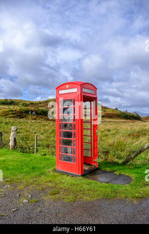Red telephone box without a door in a remote rural location on the Isle of Skye Scotland portrait format - Stock Photo
