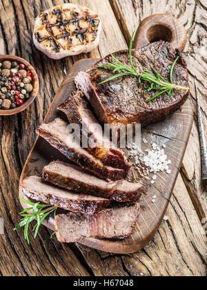 Steak Ribeye with spices on the wooden tray. - Stock Photo