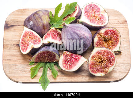 Ripe fig fruits on the cutting board. File contains clipping paths. - Stock Photo