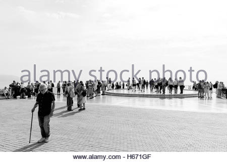 crowds of  tourists gather on the Balcón de Europa in Nerja Spain. Taken in black and white - Stock Photo