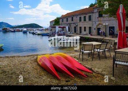 SUDURAD, CROATIA - JUNE 27, 2015: Scene of the fishing port, with boats, locals and tourists, in the village Sudurad, - Stock Photo