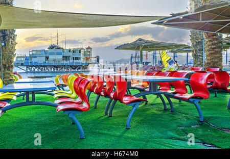 The scenic outdoor cafe, located in beach zone, next to the yacht club, Eilat - Stock Photo
