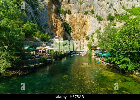 BLAGAJ, BIH - JULY 05, 2015: The Tekija, a Sufi Monastery, and the Buna River, with restaurants, locals and tourists, - Stock Photo