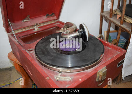Ancient dusty record player. Entertainment of residents of the Russian village of the beginning of the 20th eyelid. - Stock Photo