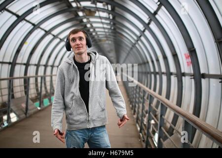 urban tunnel man listen music - Stock Photo
