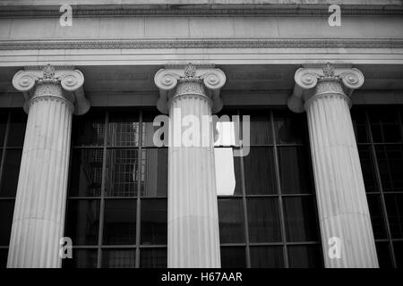 Three Ionic columns on public building in Chicago - Stock Photo