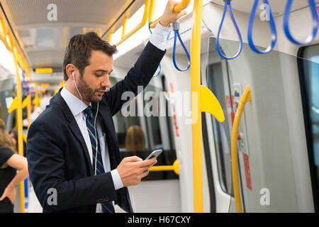 Businessman commuter traveling on the metro underground - Stock Photo