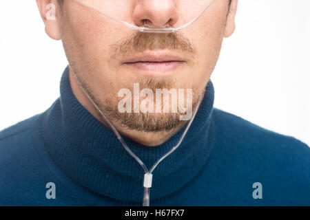 Nasal cannula for oxygen delivery on a bearded man - Stock Photo