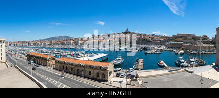Aerial skyline panoramic view of Old Port and Basilica of Notre Dame de la Garde in Marseille city, France - Stock Photo