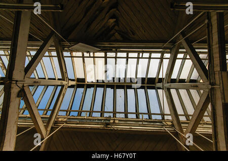 Glass skylight windows on the roof of an old Victorian building. - Stock Photo