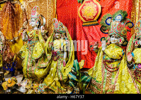 Ornate Hindu Dieties and gifts at the altar of a Temple. - Stock Photo