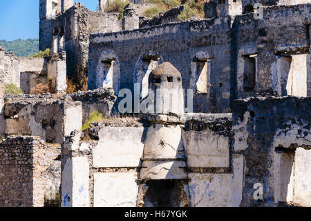 Ruins at the former Greek village of Kayakoy in Turkey, abandoned 1922, now a museum and also known as the Ghost - Stock Photo