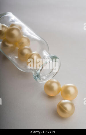 Gel capsules in a glass bottle - Stock Photo