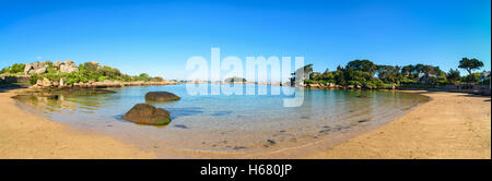 Ploumanach panorama, rocks and bay beach in morning. Pink granite coast, Perros Guirec, Brittany, France. - Stock Photo
