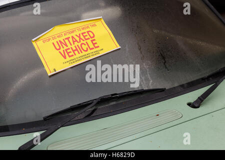 A Nissan Figaro car with 'Untaxed Vehicle' sticker attached to windshield. - Stock Photo
