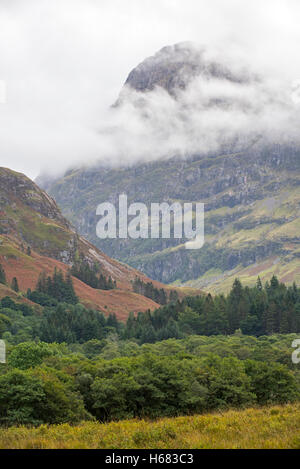 Mountain top of Bidean nam Bian and the famous Three Sisters of Glen Coe shrouded in mist, Argyll, Scottish Highlands, - Stock Photo