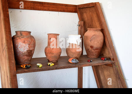 Shelves with standing on their utensils of porcelain and earthenware. Vintage kitchen utensils. - Stock Photo