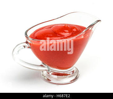 Closeup of tomato ketchup in glass bowl, isolated on white - Stock Photo
