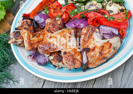 Grilled chicken wings with vegetables - Stock Photo