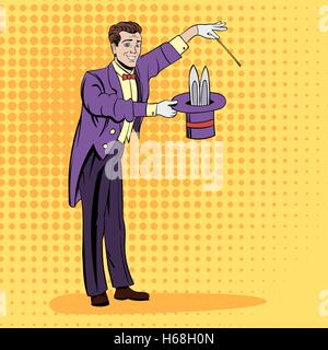 Magician pulling out a rabbit - Stock Photo