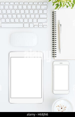 phone and tablet blank screen on white table format vertical top view - Stock Photo