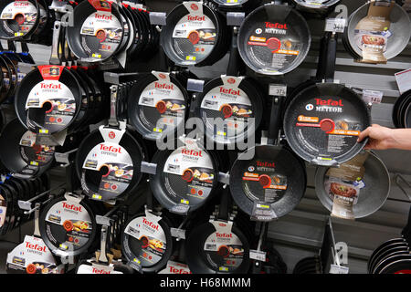 Tefal frying pans in a Carrefour Hypermarket. - Stock Photo