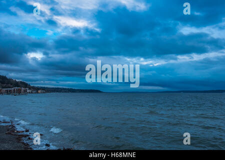 Dark storm clouds gather over the Puget Sound. Shot taken from West Seattle, Washington. - Stock Photo