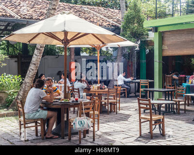 Colombo, Sri Lanka. June 10th 2016. Customers enjoy lunch at Barefoot art gallery and cafe in Colombo, Sri Lanka. - Stock Photo