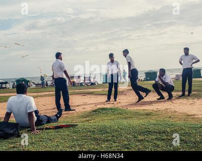 Colombo, Sri Lanka. June 10th 2016. Schoolboys play a game of hop-scotch on Galle Face Green, Sri Lanka. - Stock Photo