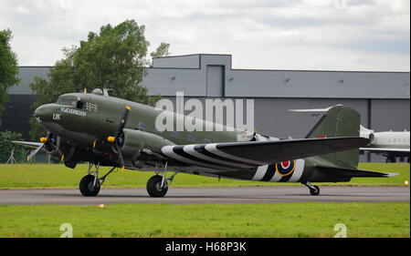 Douglas C-47A Skytrain, military version of the DC-3 Dakota,in USAAF D-Day markings at Biggin Hill Air Show, Bromley, - Stock Photo