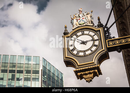 One of two clocks on the Royal Exchange on Cornhill / Threadneedle Street in the City of London, UK - Stock Photo