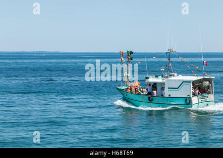 Deep sea fishing boat hand cleaning fish on the pier at for John s pass fishing