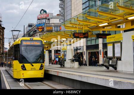 Metrolink tram at Exchange Square tramstop in Manchester. - Stock Photo