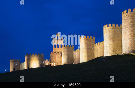 AVILA, SPAIN, APRIL - 18, 2016:The walls at dusk. - Stock Photo