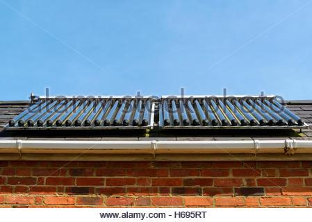 Solar evacuated tube collector panels, Dorset, England, Britain, UK - Stock Photo